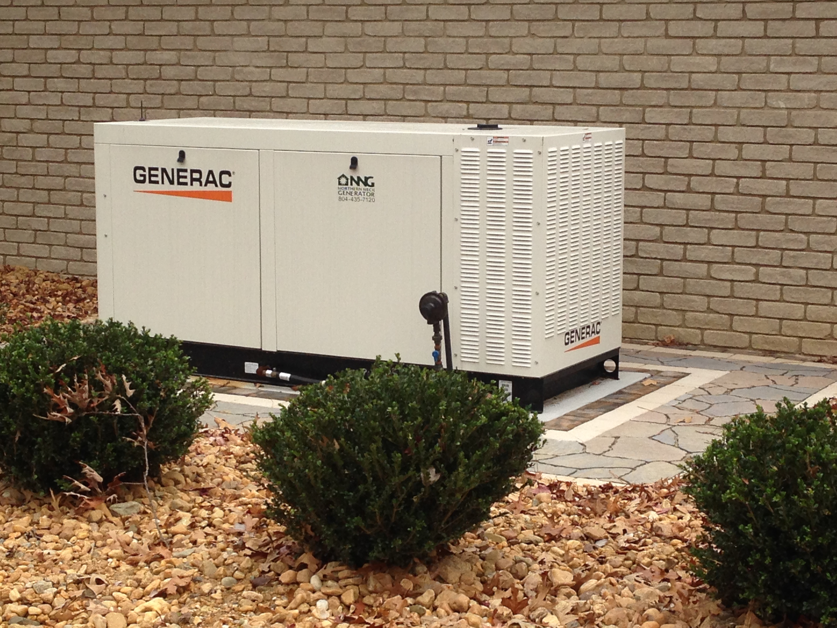 Custom concrete pad for generac 70kW generator installed by