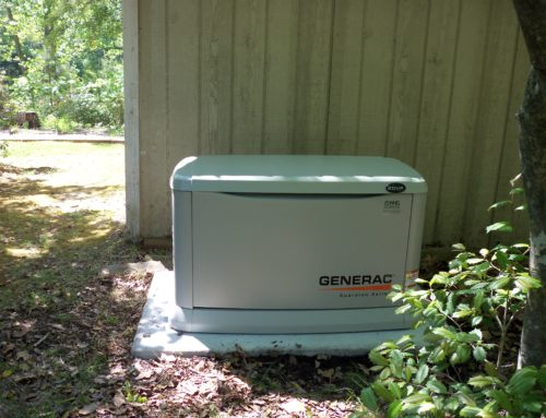 Generac 20 kilowatt whole house generator installed on a preformed concrete pad by northern neck generator