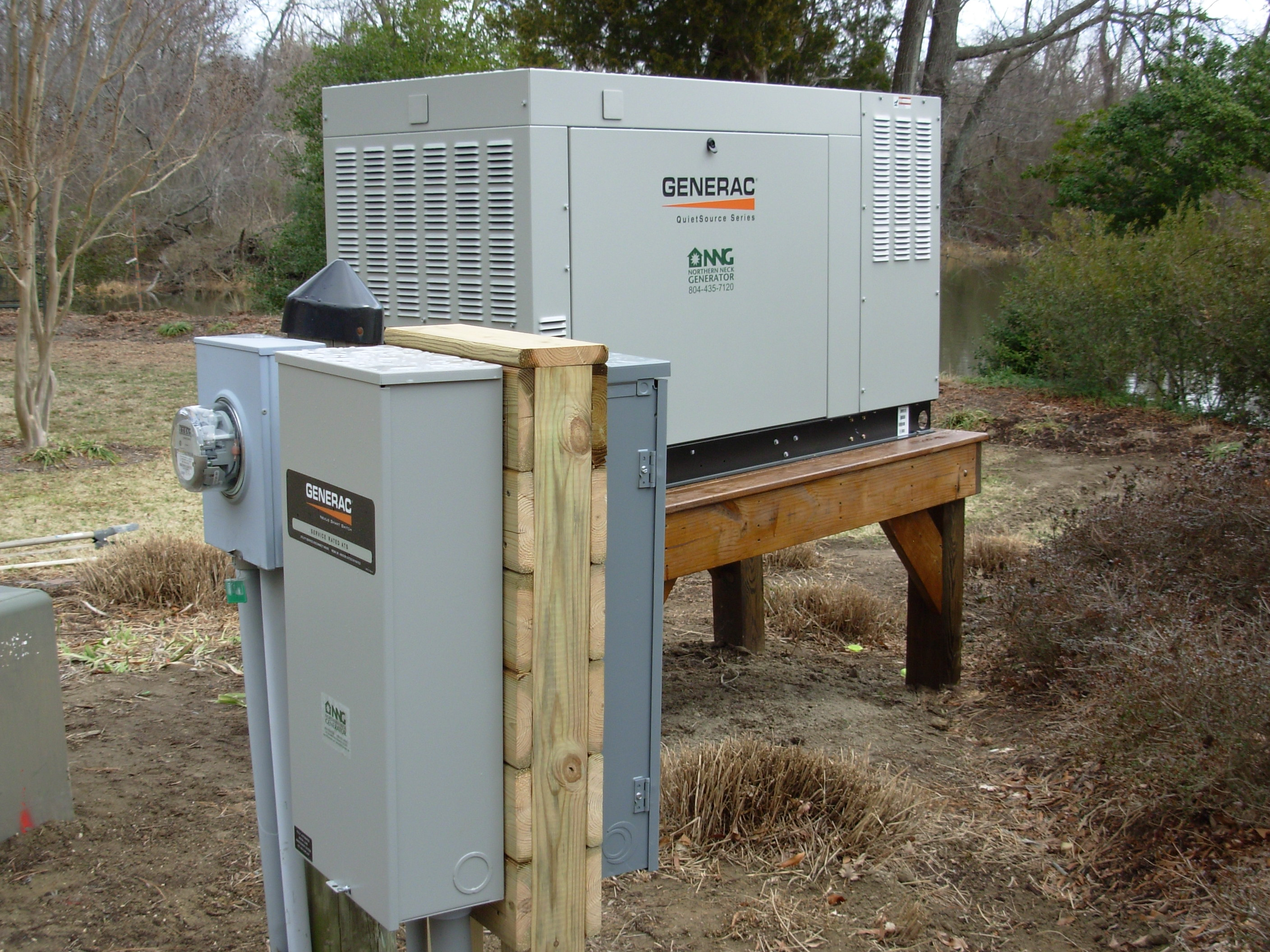 generac 48kW generator on raised platform and 200 and transfer