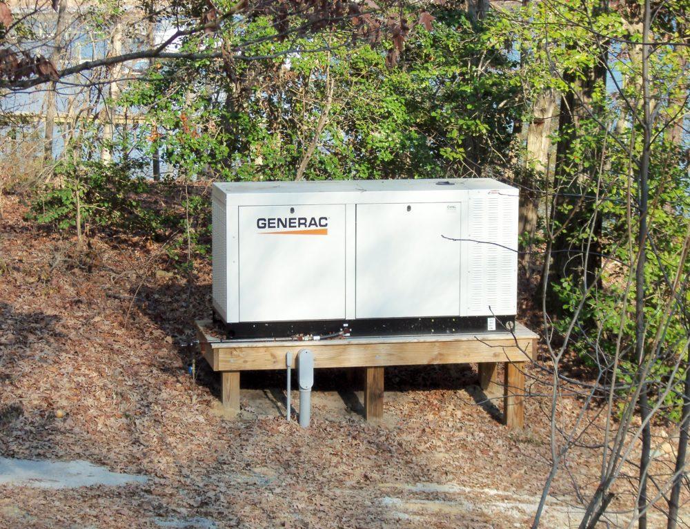generac 70 kilowatt generator installed on a raised platform by nng standby generators